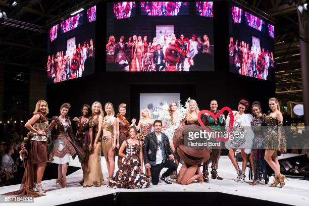 Models and Richard Orlinski pose on the runway during the Dress Chocolate show as part of Salon du Chocolat at Parc des Expositions Porte de...
