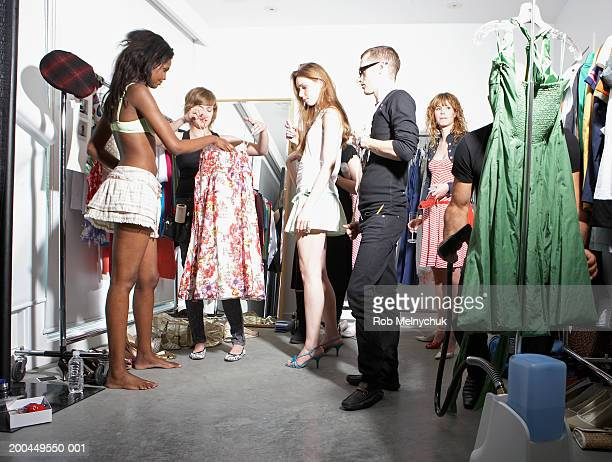 Models and stylists backstage at fashion show