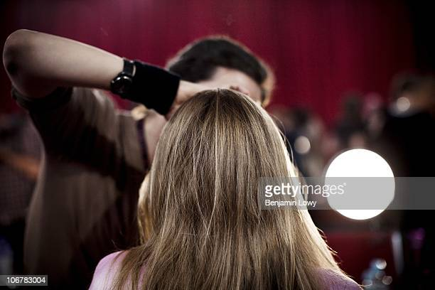Models and stylists frantically apply makeup and style hair in a backstage area prior to the 2010 Victoria's Secret Fashion show held at the 69th...