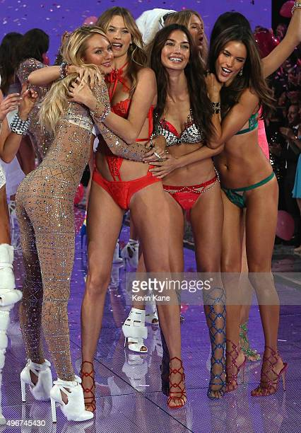 Models and Victoria's Secret Angels Candice Swanepoel Behati Prinsloo Lily Aldridge and Alessandra Ambrosio walk the runway during the 2015...