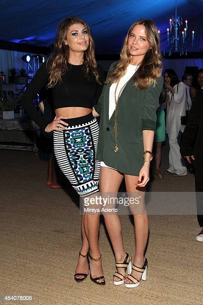 Models Angela Martini and Alicia Rountree at the Bombay Sapphire artisan series finale dinner at the Tent at Soho Beach House on December 6 2013 in...