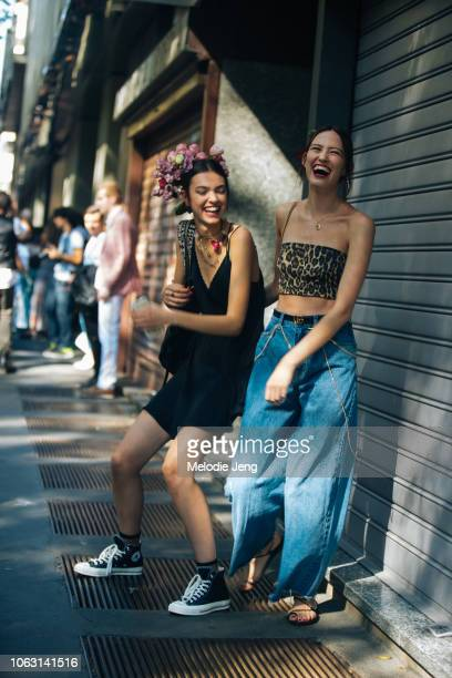 Models Ania Chiz and Margherita Tondelli after the Dolce Gabbana show with flowers in their hair during Milan Fashion Week Spring/Summer 2019 on...