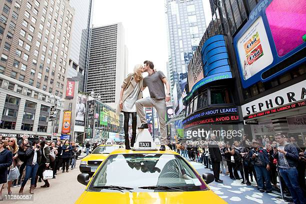 Models Anja Rubik and Sasha Knezevic attend the DKNY fragrance launch at Times Square on April 22 2011 in New York City