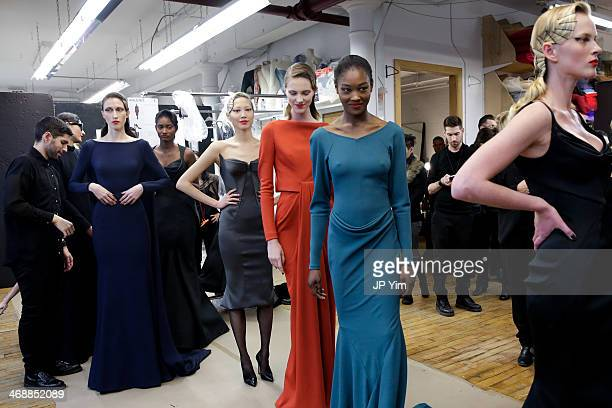 Models Anna Cleveland Melodie Monrose Soo Joo Park Betty Adewole and Anne Vyalitsyna wait backstage at the Zac Posen Fall 2014 Collection during...