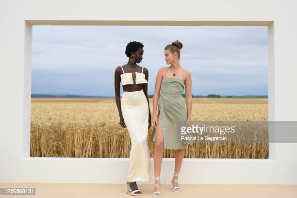 "Models, Anok Yai and Luna Bijl pose on the first line prior to ""L'Amour"" : Jacquemus Spring-Summer 2021 show on July 16, 2020 in Paris, France."