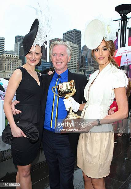 Models Anthea Crebbin and Rebecca Judd pose with milliner Philip Treacy at the 2011 Melbourne Cup Carnival Launch at Crown Towers on October 24 2011...