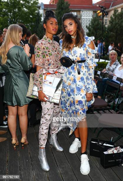 Models Anuthida Ploypetch and Taraneh Shayesteh attend the Marcel Ostertag show during the Berlin Fashion Week Spring/Summer 2019 at Westin Grand...