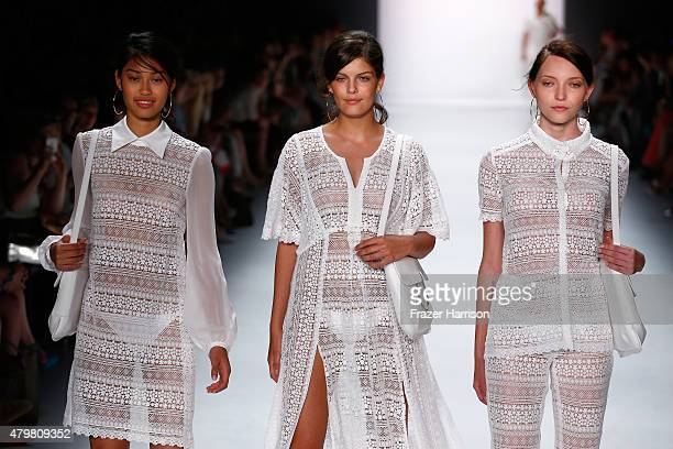 Models Anuthida Ploypetch Vanessa Fuchs and Ajsa Selimovic walk the runway at the Riani show during the MercedesBenz Fashion Week Berlin...