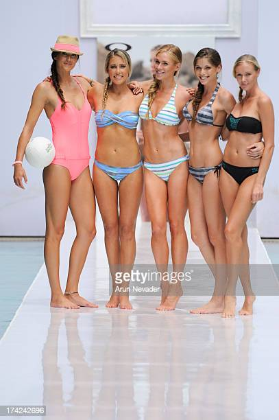 Models appear on the runway during the finale for the Oakley fashion show at MercedesBenz Fashion Week Swim 2014 Runway at the SLS Hotel on July 21...