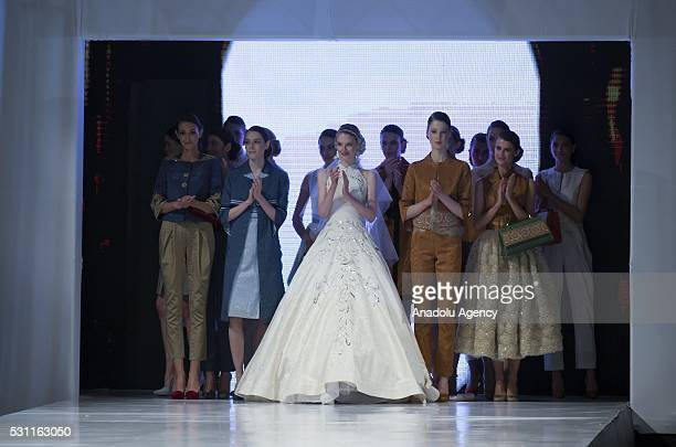 Models applaud Designer of Fashion show Rabia Yalcin after fashion show displayed a creation named ' Shine with Kutnu' targeting to give world peace...