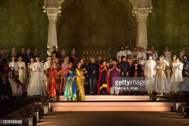 Models applaud designers Anita Dongre Rajesh Pratap Singh Anju Modi Gaurang Shah Rahul Mishra and Rohit Bal at the 'Artisan Speak' show at the Sawan...