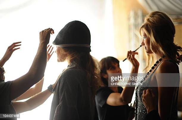 Models are getting ready backstage prior the Elena Miro springsummer 2011readytowear collection on September 22 2010 during the Women's fashion week...