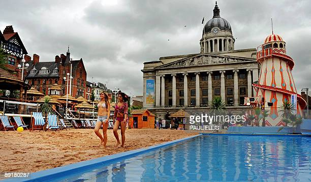 Models are pictured as they launch the 'Nottingham Riviera', Britain's largest urban beach in Nottingham, central England, on July 22, 2009. Made up...