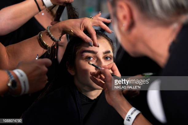 Models are pictured backstage ahead of the catwalk show for fashion house Nicopanda ahead of their catwalk show for the Spring/Summer 2019 collection...