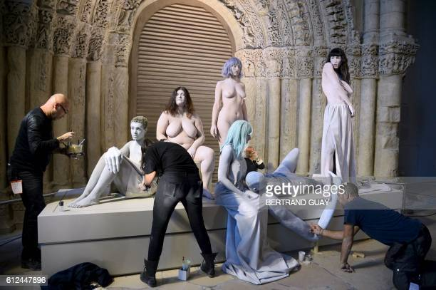 Models are prepared as part of an art performance for the set of the Kenzo 2017 Spring/Summer readytowear collection fashion show on October 4 2016...