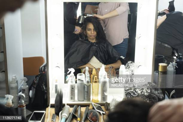 Models are prepared backstage before a catwalk show by Greek designer Mary Katranzou before her 2019 Autumn / Winter collection catwalk show at...