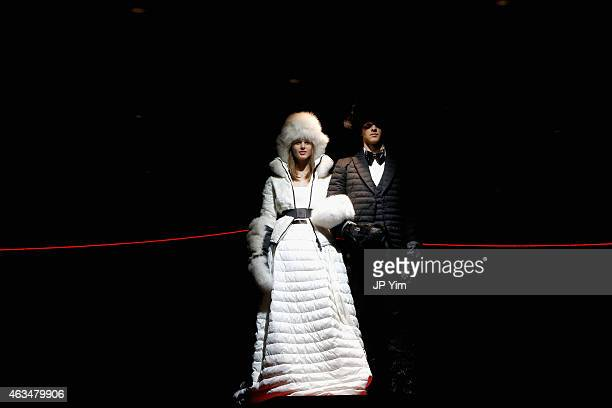 Models are raised above the runway at the Moncler Grenoble Fall/Winter 2015 fashion show during New York Fashion Week Fall 2015 at the Duggal...