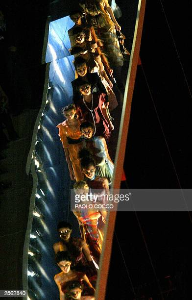 Models are reflected on the catwalk as they display Fendi collection during the Milan's 2004 Spring/Summer fashion week 04 October 2003 The Milan...