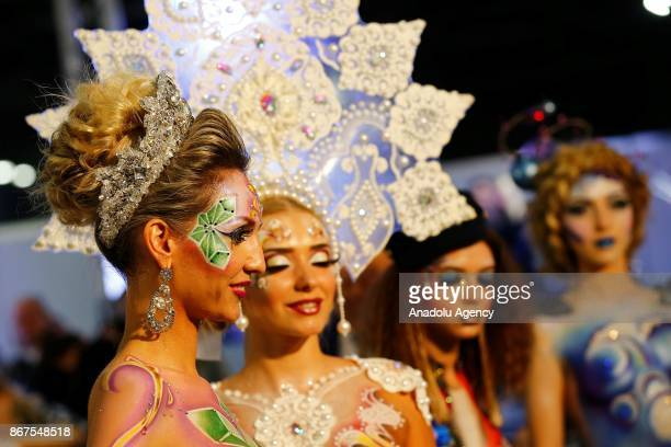 Models are seen ahead of the annual InterCHARM 2017 International Perfumery and Cosmetics Exhibition in Moscow Russia on October 28 2017
