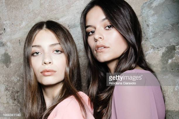 Models are seen backstage ahead of the Aniye By Fashion Show SS19 on July 16, 2018 in Milan, Italy.