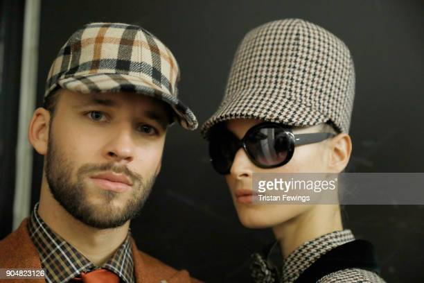 Models are seen backstage ahead of the Daks show during Milan Men's Fashion Week Fall/Winter 2018/19 on January 14 2018 in Milan Italy