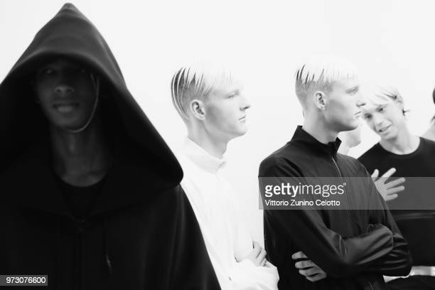 Models are seen backstage ahead of the Fumito Ganryu show during the 94th Pitti Immagine Uomo on June 13 2018 in Florence Italy