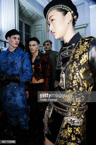 Models are seen backstage ahead of the Moschino show during Milan Men's Fashion Week Fall/Winter 2017/18 on January 14 2017 in Milan Italy