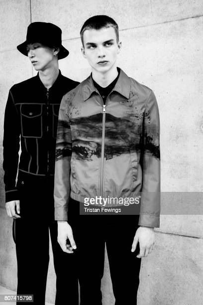 Image converted to black and white Models are seen backstage ahead of the Neil Barrett show during Milan Men's Fashion Week Spring/Summer 2018on June...