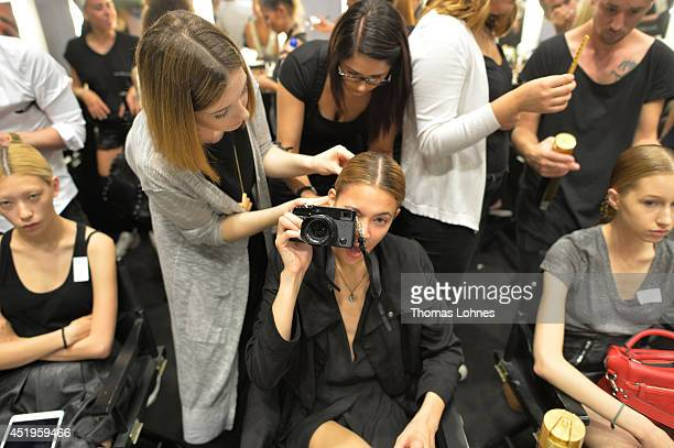 Models are seen backstage ahead of the Roshi Porkar show during the MercedesBenz Fashion Week Spring/Summer 2015 at Erika Hess Eisstadion on July 10...