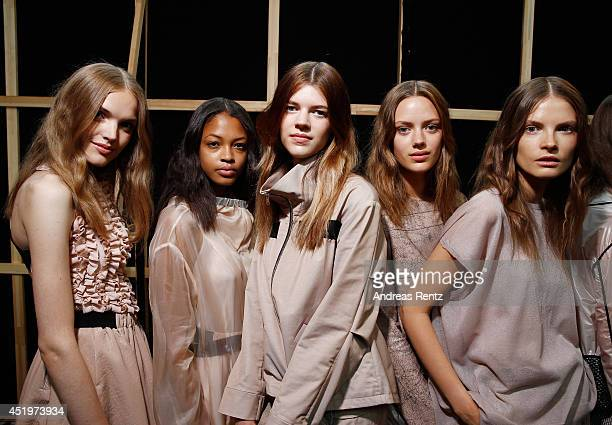 Models are seen backstage ahead of the Schumacher show during the MercedesBenz Fashion Week Spring/Summer 2015 at Sankt Elisabeth Kirche on July 10...