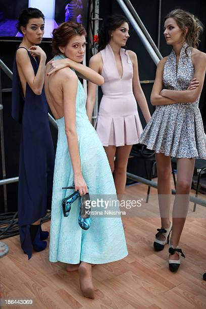 Models are seen backstage at the Nikolai Kyvyrzhik by SLAVA ZAITSEV show during MercedesBenz Fashion Week Russia S/S 2014 on October 31 2013 in...