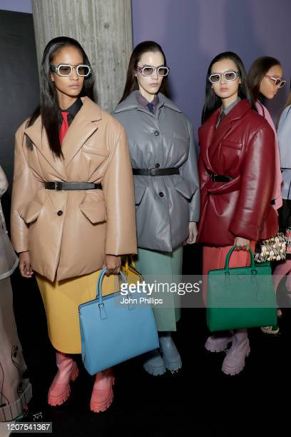 Models are seen backstage at the Prada fashion show on February 20, 2020 in Milan, Italy.