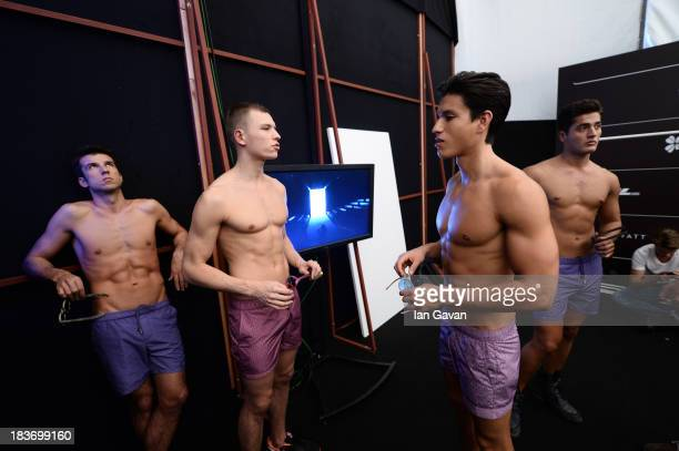 A models are seen backstage at the Serdar Uzuntas show during MercedesBenz Fashion Week Istanbul s/s 2014 presented by American Express on October 9...