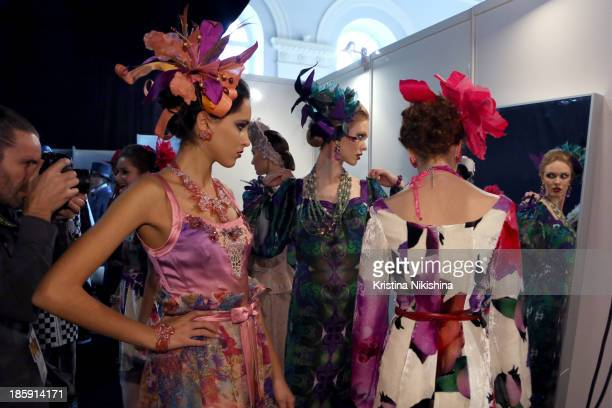 Models are seen backstage at the SLAVA ZAITSEV PretAporter De Luxe show during the MercedesBenz Fashion Week Russia S/S 2014 on October 26 2013 in...