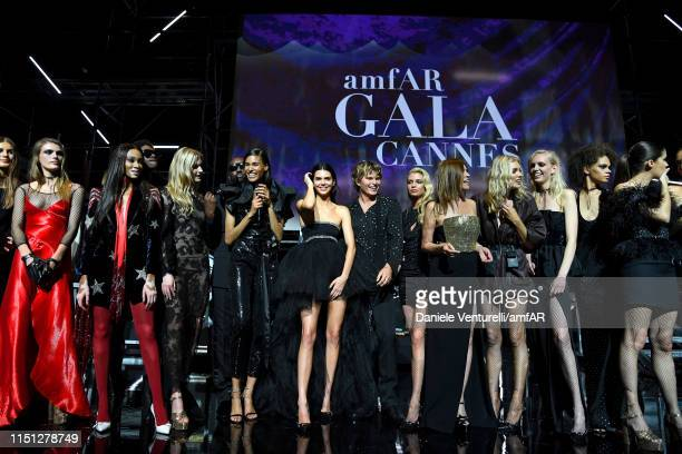 Models are seen on stage during the amfAR Cannes Gala 2019 at Hotel du Cap-Eden-Roc on May 23, 2019 in Cap d'Antibes, France.