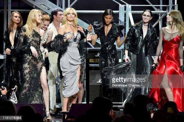 Models are seen on stage during the amfAR Cannes Gala 2019 at Hotel du CapEdenRoc on May 23 2019 in Cap d'Antibes France