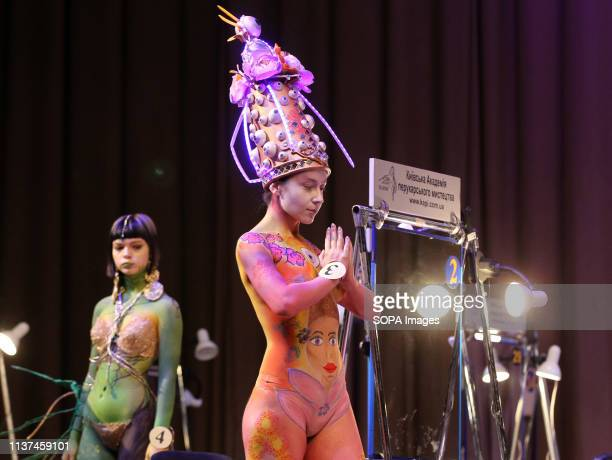 Models are seen showcasing designs during the annual international hairdressers festival Crystal Angel in Kiev The hairdressers and makeup artists...