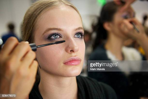Models are styled backstage at the Temperley autumn 2011 collection at The British Museum in London on 20 February 2011. This runway show marked the...
