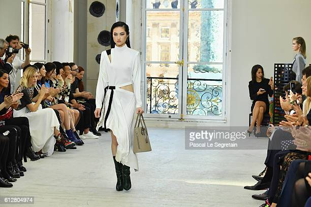 Models arrive on the runway at the end of the Louis Vuitton show as part of the Paris Fashion Week Womenswear Spring/Summer 2017 on October 5 2016 in...