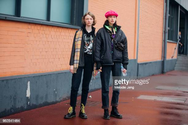Models Asta Stensson Elsa Sjokvist after the Balenciaga show on March 04 2018 in Paris France Asta wears a yellow Burberry classic check scarf and an...