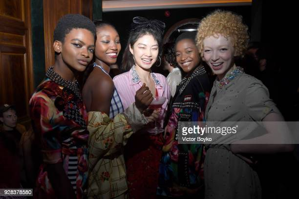 Models attend the Miu Miu after show as part of the Paris Fashion Week Womenswear Fall/Winter 2018/2019 on March 7 2018 in Paris France