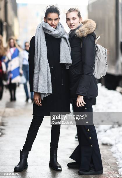 Models Austria Ulloa and Lisa Helene Kramer are seen outside of the Milly show during New York Fashion Week Women's Fall/Winter 2017 on February 10...