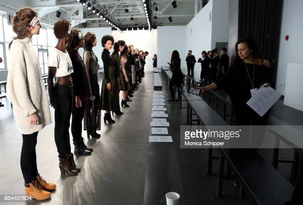 Models await instructions during rehearsal before the Ane Amour fashion show during New York Fashion Week at Pier 59 on February 9 2017 in New York...