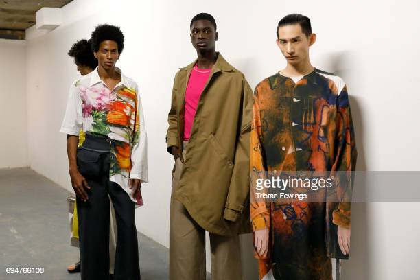 Models backstage ahead of the Alex Mullins show during the London Fashion Week Men's June 2017 collections on June 11 2017 in London England