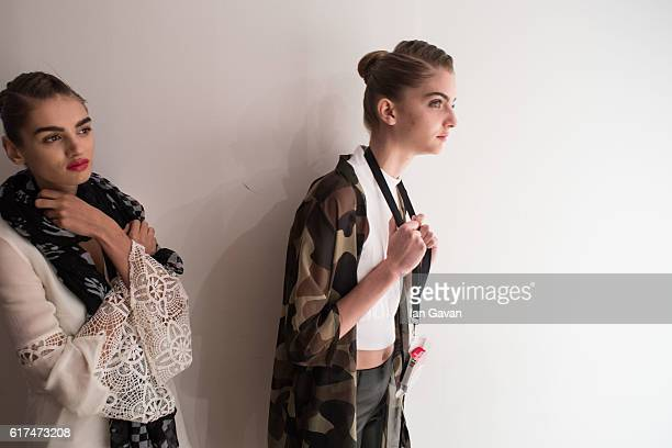 Models backstage ahead of the Amira Haroon presentation during Fashion Forward Spring/Summer 2017 at the Dubai Design District on October 23 2016 in...