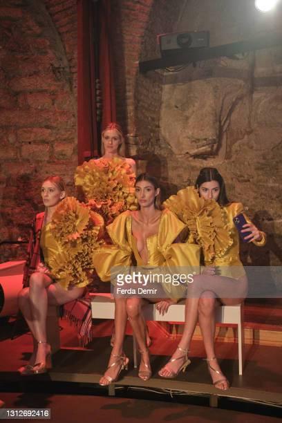 Models backstage ahead of the Cihan Nacar Lookbook for Istanbul Fashion Week on April 15, 2021 in Istanbul, Turkey.