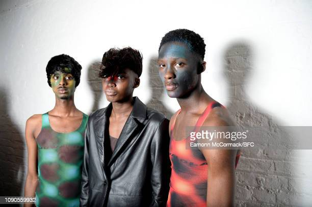 Models backstage ahead of the Fashion East show during London Fashion Week Men's January 2019 at the BFC Show Space on January 06 2019 in London...