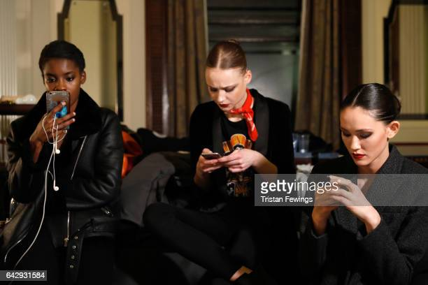 Models backstage ahead of the Hallie Sara show during the London Fashion Week February 2017 collections on February 19 2017 in London England