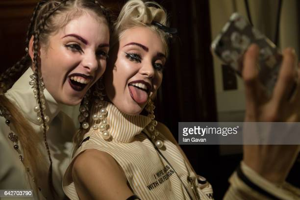 Models backstage ahead of the Han Wen show at Fashion Scout during the London Fashion Week February 2017 collections on February 18, 2017 in London,...