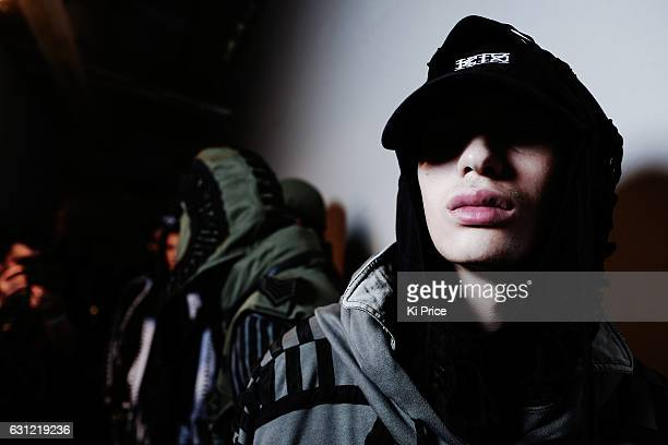 Models backstage ahead of the KTZ show during London Fashion Week Men's January 2017 collections at BFC Show Space on January 8 2017 in London England